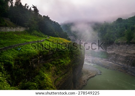 Morning fog in the gorge at Letchworth State Park, New York. - stock photo