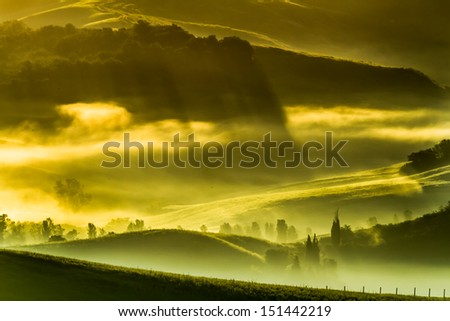 Morning fog in the valley, Italy - stock photo