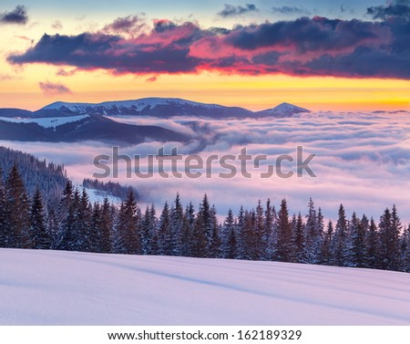 Morning fog in the winter mountains. 10 minutes before sunrise. - stock photo