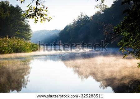 Morning fog on a calm river, tranquil scene on Seversky Donets river, Ukraine - stock photo