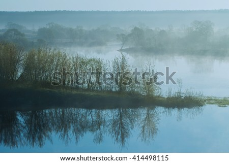 Morning fog on a river - stock photo