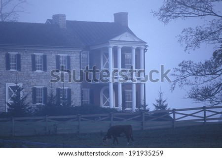 Morning fog over residence along Scenic Highway US Route 219, WV - stock photo