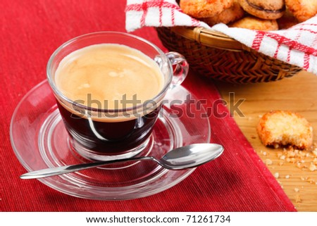 Morning fresh espresso coffee served with cookies - stock photo
