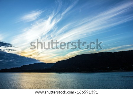 Morning glory in Norwegian cruise. Mountain seascape - stock photo