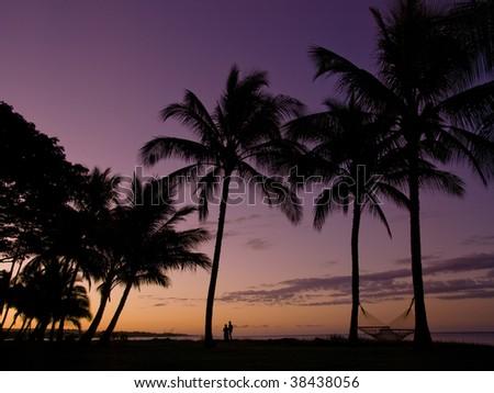 Morning glow and couple on the beach at the Kauai, Hawaii - stock photo
