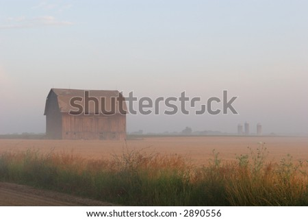 Morning Haze. The hazy morning on the farm after the annual harvest. - stock photo