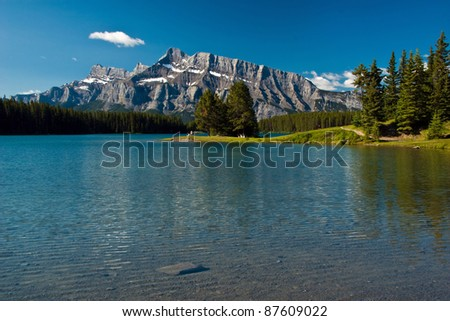 Morning in Banff National park, Lake with mountains on background. - stock photo
