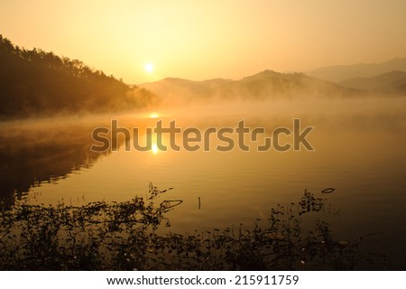 Morning in mountains with Sun rising - stock photo