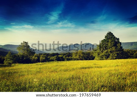 Morning in mountains with Sun rising rural scenery - stock photo