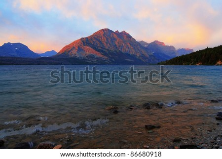 Morning in the mountains with Lake St. Mary as foreground for this sunrise in Glacier National Park,  Montana.  HDR image.
