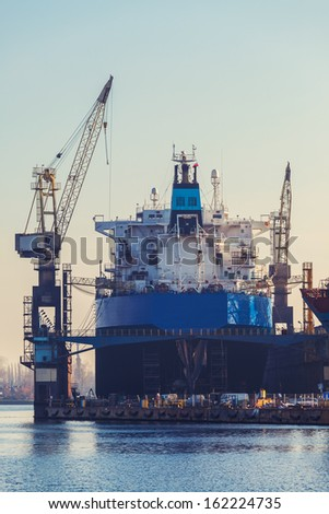 Morning in the yard - the ship in dry dock. - stock photo