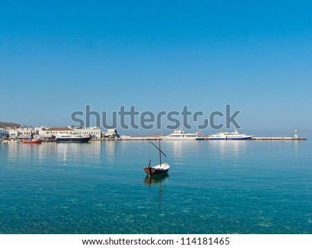 Morning in Valletta, Malta. Small boat in the chrystal clear bay's water. - stock photo
