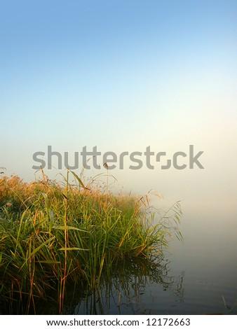 morning lake and fog after sunrise - stock photo