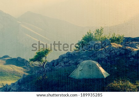 Morning landscape with a tent. Camping in the Spring Mountains. Filtered image: vintage, grunge and texture effects - stock photo