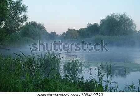 Morning landscape with fog on the river - stock photo