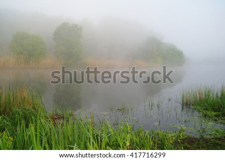 Morning landscape with fog on the river. - stock photo