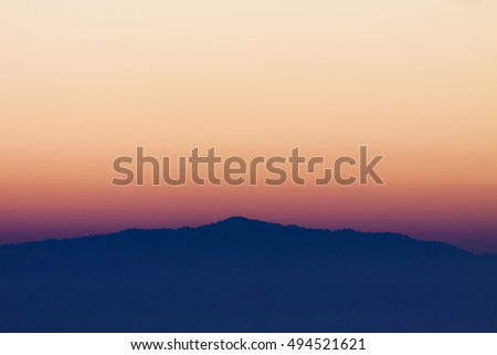 Morning landscape with mountains silhouette just before sunrise.