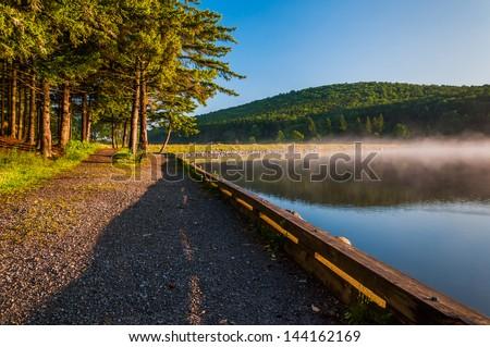 Morning light and fog on Spruce Knob Lake, Monongahela National Forest, West Virginia. - stock photo