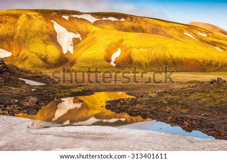 Morning light illuminates the mountains and glaciers national park in Iceland.Magic sunrise in the Arctic - stock photo