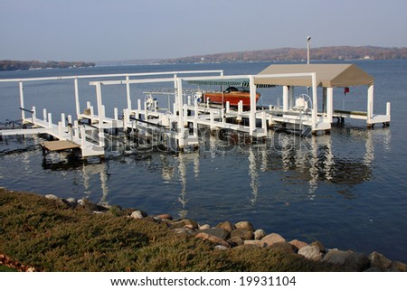 Morning light on the docks on Geneva Lake in Wisconsin - stock photo