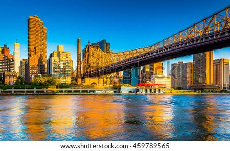 Morning light on the Manhattan skyline and Queensboro Bridge, seen from Roosevelt Island, New York. - stock photo