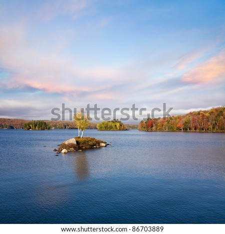 Morning Light Over Tupper Lake During Autumn In The Adirondack Mountains, New York, USA - stock photo