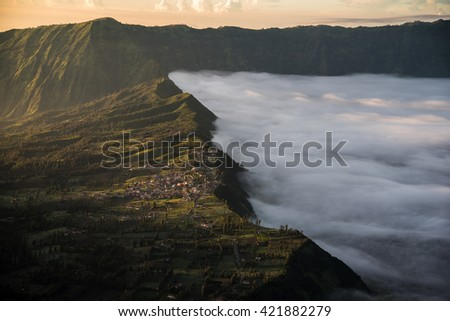 Morning Light with the misty in Cemoro lawang village at mount Bromo in Bromo tengger semeru national park, East Java, Indonesia - stock photo