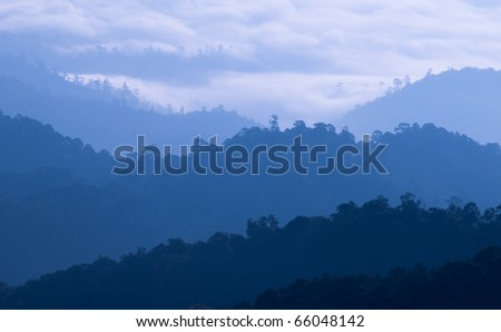 Morning Mist at Tropical Mountain Range, Thailand - stock photo