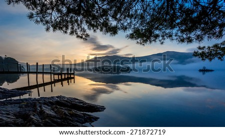 Morning mist on Derwentwater, Keswick, The Lake District, Cumbria, England - stock photo