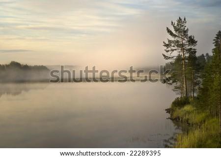 Morning mist over a river in Halsingland, Sweden. - stock photo