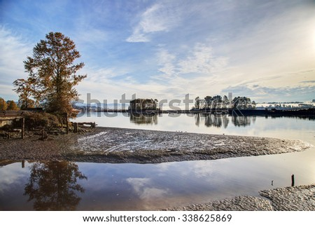 morning mist over river in autumn - stock photo