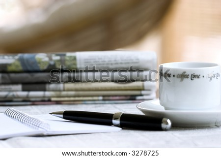 morning newspapers, coffee, notebook with pen - stock photo