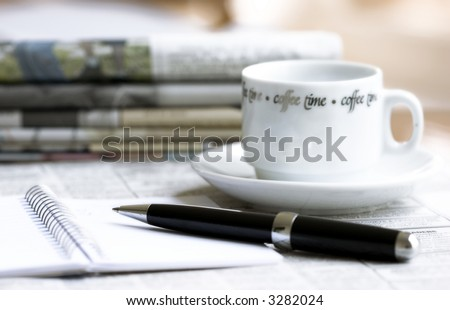 morning newspapers, cup of coffee and pen with notebook - stock photo