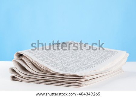 Morning newspapers on the table, closeup shot - stock photo