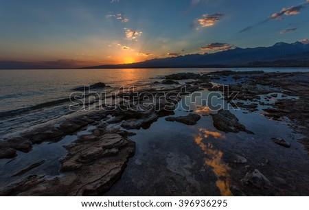 Morning on mountain lake Issyk-Kul, Kyrgyzstan - stock photo