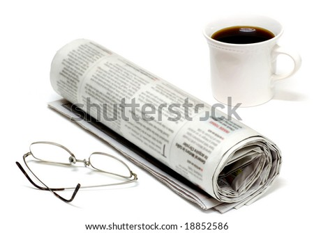 Morning paper with glasses and coffee - stock photo