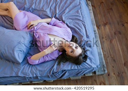Morning picture of woman lying in her bedroom shoot from above