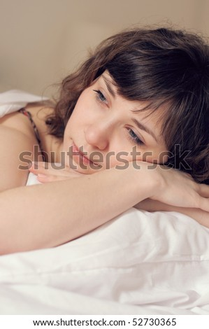 Morning portrait of a girl in a bed