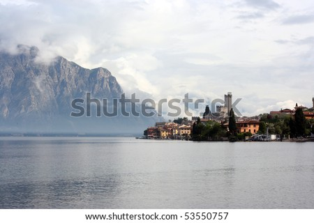 Morning resort Malcesine in clouds - stock photo