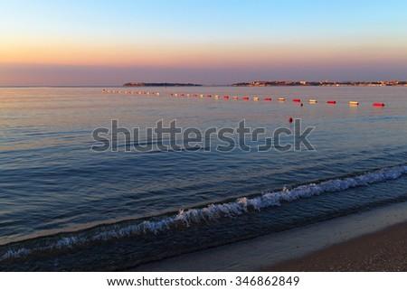 Morning seascape. Calm sea and the beach. - stock photo