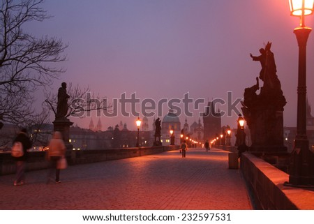 Morning shootings on Charles Bridge in the city of Prague - stock photo