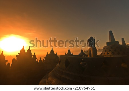Morning silhouette of Buddha image on  Borobudur temple,Yogyakarta. Java, Indonesia. - stock photo