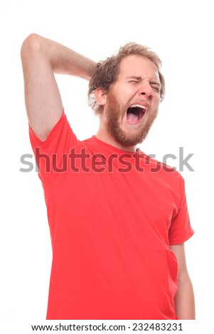 Morning stretching and yawns of young bearded man - stock photo