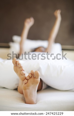 Morning stretching in comfortable bed
