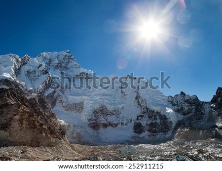 Morning sun above Nuptse from the way to Mount Everest base camp - Nepal  - stock photo