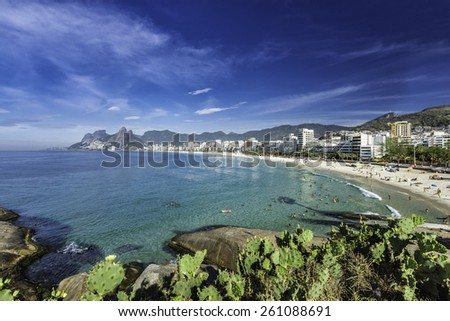 Morning sun on Ipanema Beach with city panorama in Rio de Janeiro,Brazil - stock photo