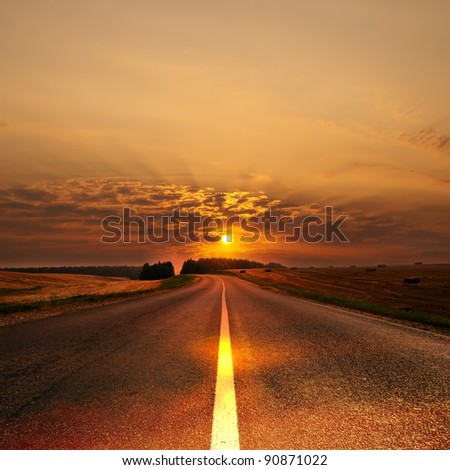 Morning sun over road leaving afar