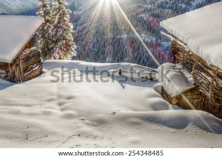Morning sun over the ski hut in HDR - stock photo