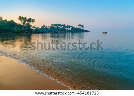 morning sun rays on a beautiful beach - stock photo