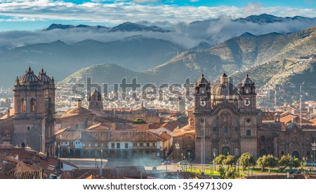Morning sun rising at Plaza de armas with Adean Moutain and group of cloud, Cusco, Peru - stock photo